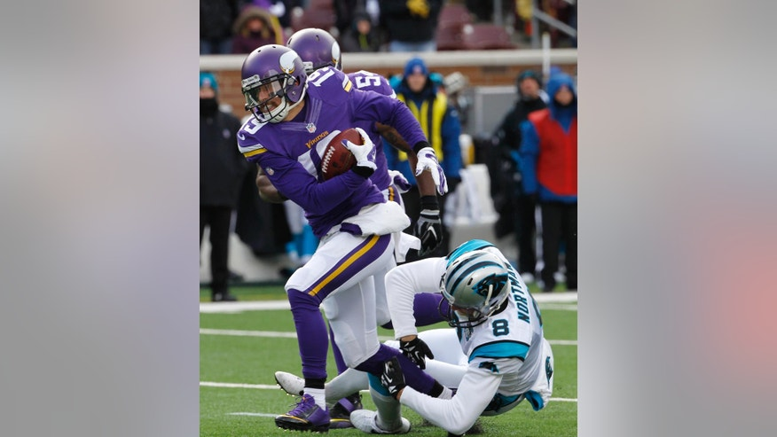 Minnesota Vikings wide receiver Adam Thielen (19) runs from Carolina Panthers punter Brad Nortman (8) as he returns a blocked punt for a touchdown during the first half of an NFL football game, Sunday, Nov. 30, 2014, in Minneapolis. (AP Photo/Ann Heisenfelt)