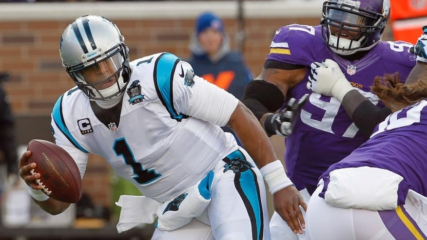 Carolina Panthers quarterback Cam Newton (1) scrambles from Minnesota Vikings defensive end Everson Griffen, right, during the first half of an NFL football game, Sunday, Nov. 30, 2014, in Minneapolis. (AP Photo/Ann Heisenfelt)