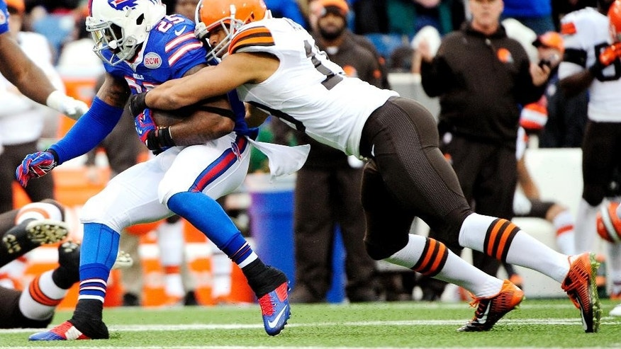 Buffalo Bills strong safety Da'Norris Searcy, left, is tackled by Cleveland Browns wide receiver Miles Austin after Searcy intercepted a pass from Browns quarterback Brian Hoyer during the first half of an NFL football game, Sunday, Nov. 30, 2014, in Orchard Park, N.J. (AP Photo/Gary Wiepert)
