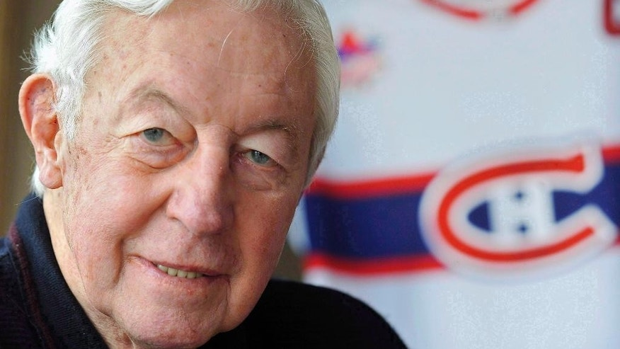 FILE - In this Nov. 25, 2009, file photo, Montreal Canadiens great Jean Beliveau poses at his home in St. Lambert, Quebec. Beliveau died Tuesday, Dec. 2, 2014. He was 83. The team confirmed the death of the Hall of Fame center and one of the most beloved players in Canadiens history. (AP Photo/The Canadian Press, Graham Hughes, File)