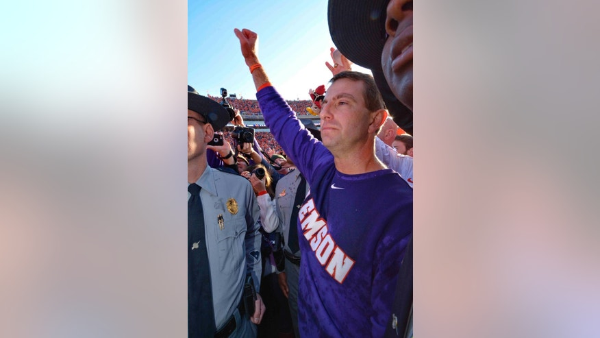 Clemson head coach Dabo Swinney celebrates after an NCAA college football game against South Carolina in Clemson, S.C., Saturday, Nov. 29, 2014. Clemson won 35-17. (AP Photo/Richard Shiro)