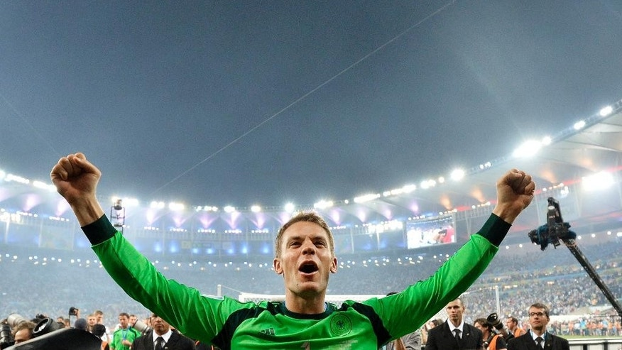 FILE - In this July 13, 2014 file photo Germany's goalkeeper Manuel Neuer celebrates after the World Cup final soccer match between Germany and Argentina at the Maracana Stadium in Rio de Janeiro, Brazil, Sunday, July 13, 2014. Germany won the match 1-0. Forwards Cristiano Ronaldo of Portugal and Lionel Messi of Argentina are finalists for the men's honor along with German goalkeeper Manuel Neuer, FIFA said Monday, Dec. 1, 2014. Ronaldo won in 2008 and 2013, while Messi won four in a row from 2009-12. (AP Photo/Martin Meissner)
