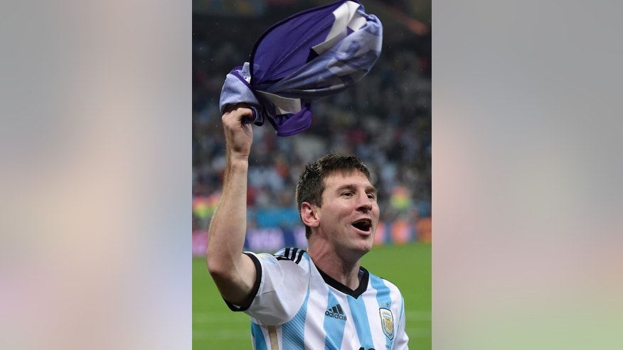 FILE - The July 9, 2014 file photo shows Argentina's Lionel Messi celebrating after winning a shootout at the end of the World Cup semifinal soccer match between the Netherlands and Argentina at the Itaquerao Stadium in Sao Paulo Brazil. Forwards Cristiano Ronaldo of Portugal and Lionel Messi of Argentina are finalists for the men's honor along with German goalkeeper Manuel Neuer, FIFA said Monday, Dec. 1, 2014. Ronaldo won in 2008 and 2013, while Messi won four in a row from 2009-12.  (AP Photo/Manu Fernandez)