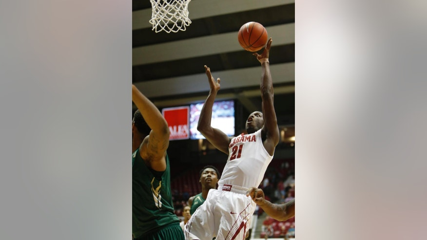Alabama guard Rodney Cooper (21) shoots the ball against the South Florida in the first half of an NCAA college basketball game, Tuesday, Dec. 2, 2014, in Tuscaloosa, Ala. (AP Photo/The Tuscaloosa News, Robert Sutton)