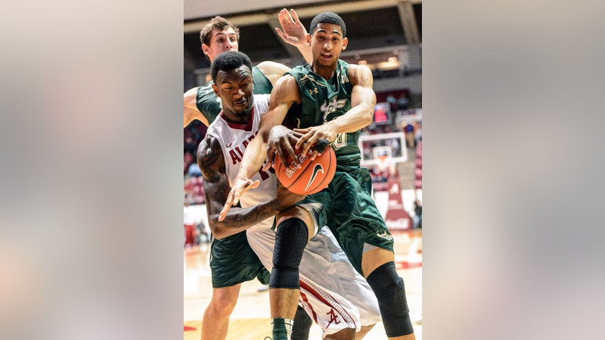 Alabama forward Jimmie Taylor (10) and South Florida guard Dinero Mercurius (20) battle for the ball during an NCAA college basketball game, Tuesday, Dec. 2, 2014, at Coleman Coliseum in Tuscaloosa, Ala. (AP Photo/AL.com, Vasha Hunt) MAGS OUT