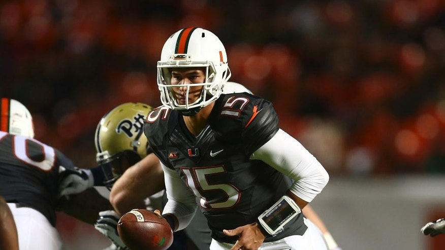 Miami quarterback Brad Kaaya runs plays against Pittsburgh during the first half of an NCAA college football game in Miami Gardens, Fla., Saturday, Nov. 29, 2014. (AP Photo/J Pat Carter)