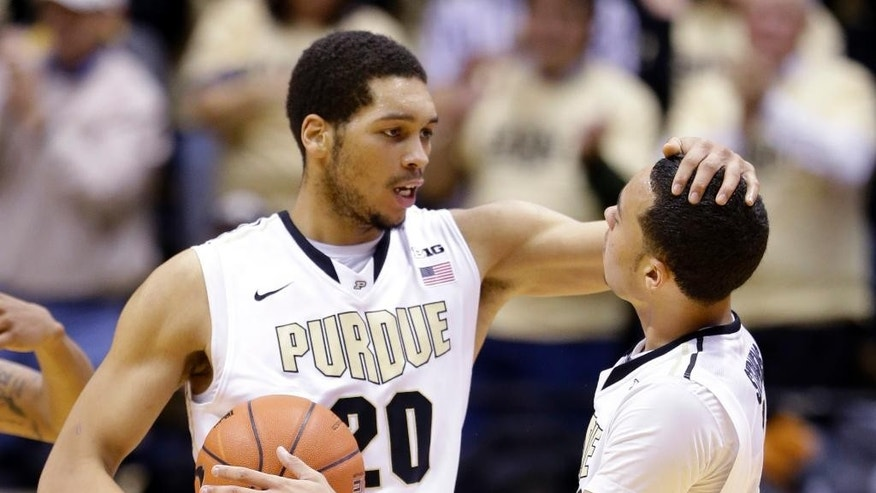 Purdue guard Kendall Stephens, right in congratulated by teammate A.J. Hammons as Purdue defeated North Carolina State 66-61 in an NCAA college basketball game in West Lafayette, Ind., Tuesday, Dec. 2, 2014.  (AP Photo/Michael Conroy)