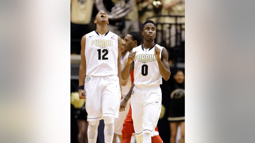 Purdue guard Jon Octeus, right, and forward Vince Edwards celebrate as Purdue defeated North Carolina State 66-61 in an NCAA college basketball game in West Lafayette, Ind., Tuesday, Dec. 2, 2014.  (AP Photo/Michael Conroy)