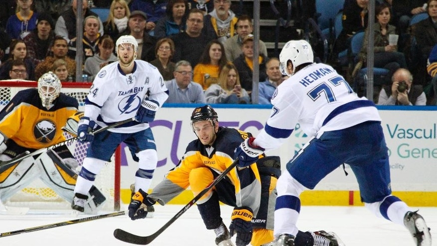 Buffalo Sabres' Zemgus Girgensons (28), of Latvia, reaches to block a pass by Tampa Bay Lightning's Victor Hedman (77), of Sweden, during the second period of an NHL hockey game Tuesday, Dec. 2, 2014, in Buffalo, N.Y. (AP Photo/Jen Fuller)