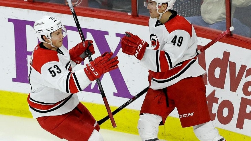 Carolina Hurricanes' Jeff Skinner (53) and Victor Rask (49), of Sweden, celebrate Rask's goal against the Nashville Predators during the third period of an NHL hockey game in Raleigh, N.C., Tuesday, Dec. 2, 2014. Carolina won 2-1. (AP Photo/Gerry Broome)