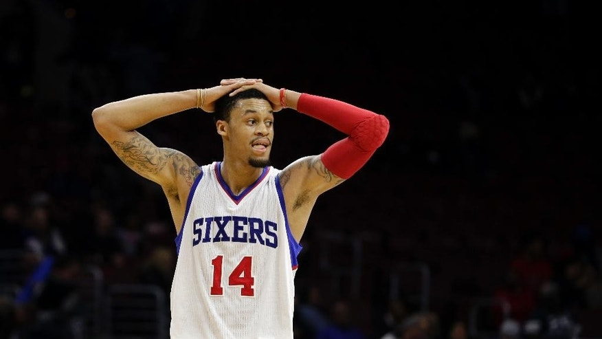 Philadelphia 76ers' K.J. McDaniels walks the court during the final minute of an NBA basketball game against the San Antonio Spurs, Monday, Dec. 1, 2014, in Philadelphia. San Antonio won 109-103. (AP Photo/Matt Slocum)