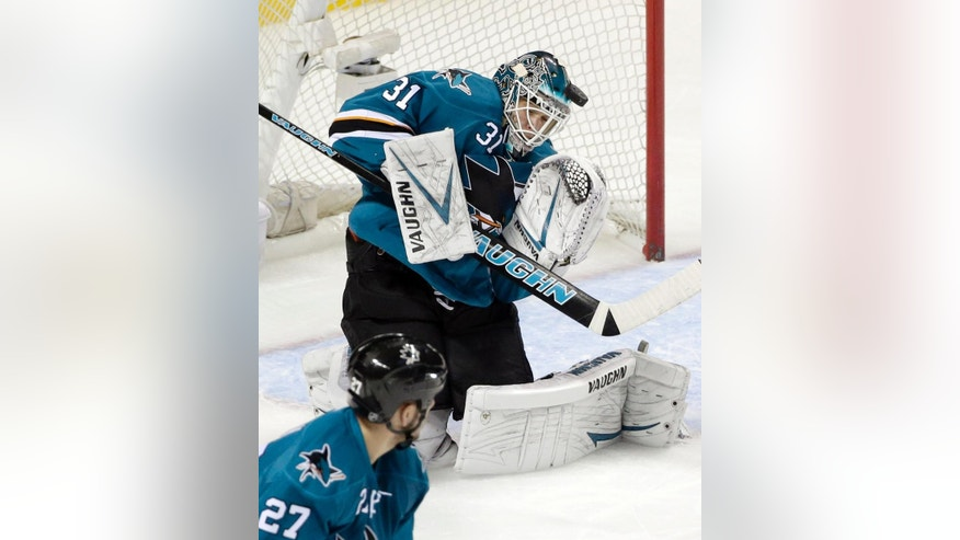 San Jose Sharks goalie Antti Niemi, of Finland, stops a shot against the Philadelphia Flyers during the first period of an NHL hockey game Tuesday, Dec. 2, 2014, in San Jose, Calif. (AP Photo/Marcio Jose Sanchez)