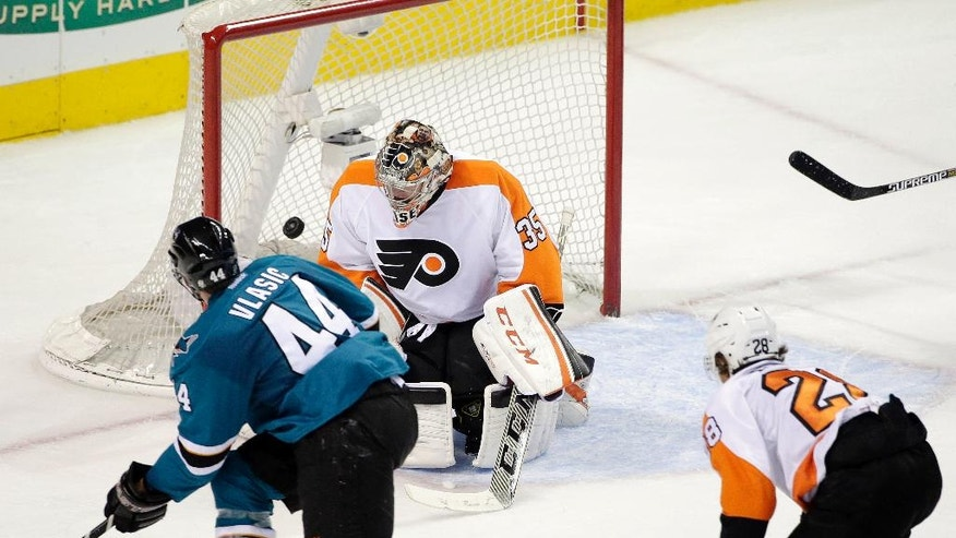 San Jose Sharks defenseman Marc-Edouard Vlasic (44) scores past Philadelphia Flyers goalie Steve Mason (35) during the second period of an NHL hockey game Tuesday, Dec. 2, 2014, in San Jose, Calif. (AP Photo/Marcio Jose Sanchez)