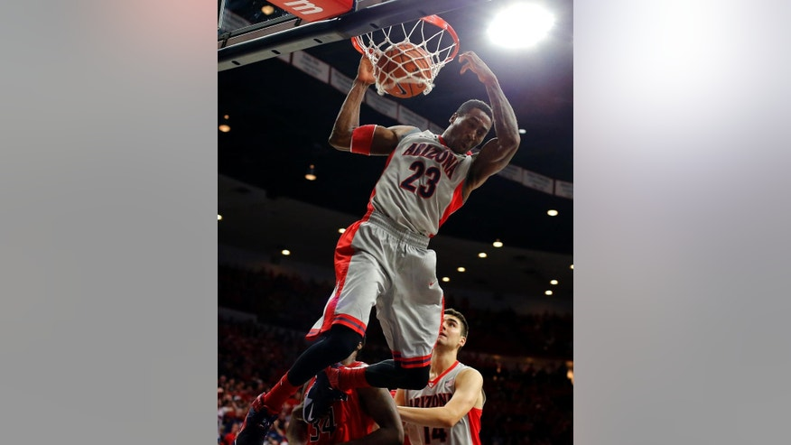 Arizona forward Rondae Hollis-Jefferson (23) dunks during the second half of an NCAA college basketball game against Gardner Webb, Tuesday, Dec. 2, 2014, in Tucson, Ariz. (AP Photo/Rick Scuteri)