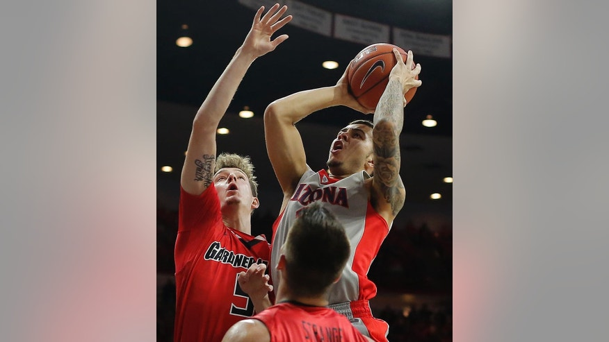 Arizona guard Gabe York (1), right, shoots over Gardner Webb guard Dylan Poston (5) during the second half of an NCAA college basketball game, Tuesday, Dec. 2, 2014, in Tucson, Ariz. (AP Photo/Rick Scuteri)