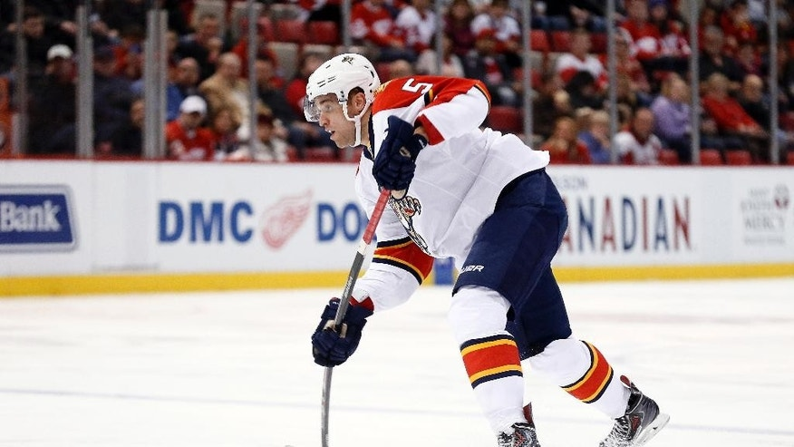 Florida Panthers defenseman Aaron Ekblad shoots against the Detroit Red Wings in the first period during an NHL hockey game in Detroit Tuesday, Dec. 2, 2014. (AP Photo/Paul Sancya)