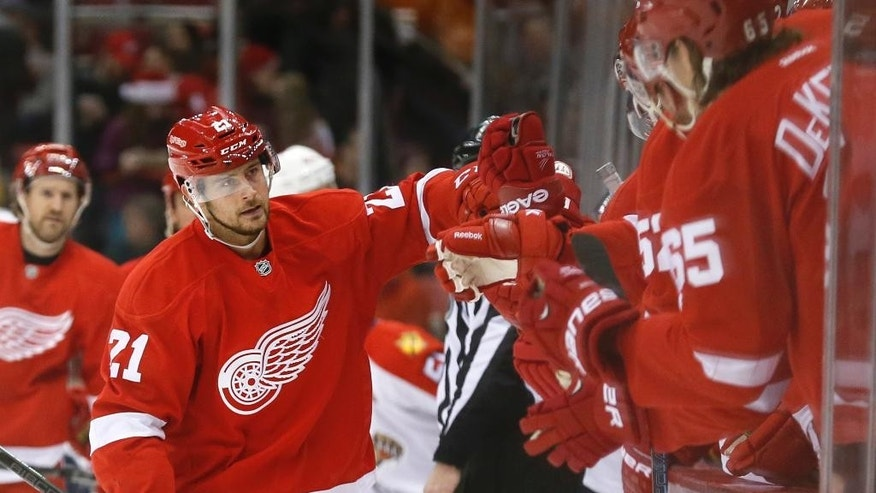 Detroit Red Wings left wing Tomas Tatar (21) celebrates his goal against the Florida Panthers in the first period during an NHL hockey game in Detroit Tuesday, Dec. 2, 2014. (AP Photo/Paul Sancya)