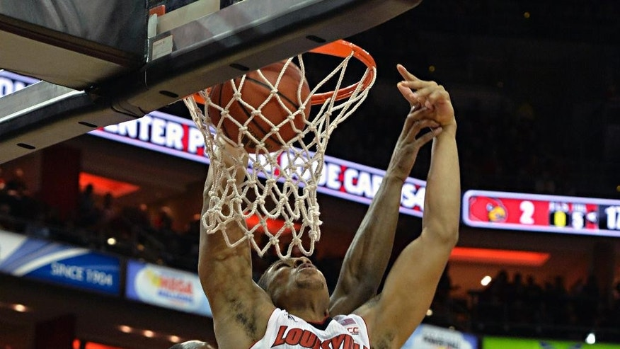 Louisville's Wayne Blackshear (25) dunks the basketball despite the defensive efforts of Ohio State's Sam Thompson (12) during the first half of an NCAA college basketball game Tuesday, Dec. 2, 2014, in Louisville, Ky. (AP Photo/Timothy D. Easley)
