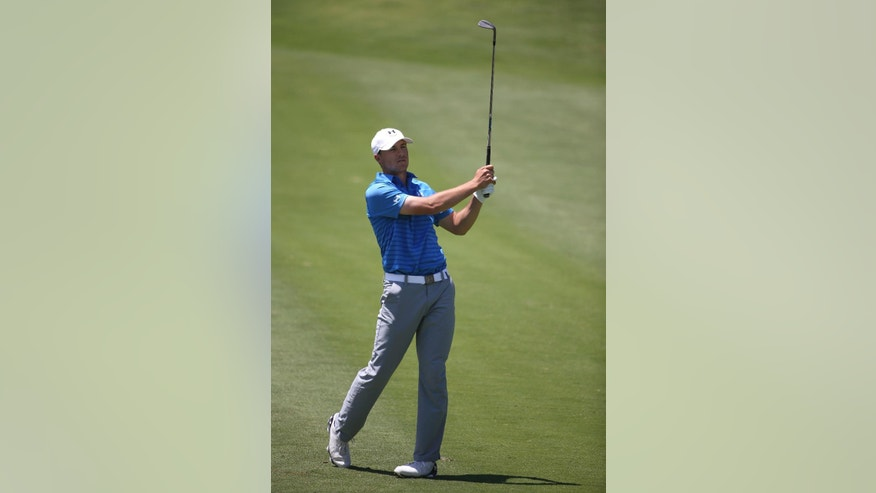 Jordan Spieth of the US plays a shot from the 7th fairway during the final round of the Australian Open golf championship in Sydney, Sunday, Nov. 30, 2014. Spieth started the day co-leader at 5 under. (AP Photo/Rick Rycroft)