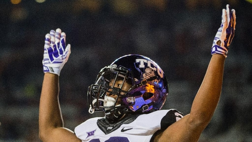 TCU's Aaron Green (22) celebrates a touchdown during the second half of an NCAA college football game against Texas, Thursday, Nov. 27, 2014, in Austin, Texas. (AP Photo/Ashley Landis)