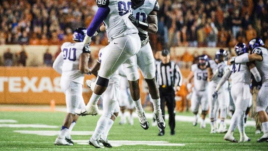 TCU's Chucky Hunter (96) and James McFarland (40) celebrate a touchdown during the second half of an NCAA college football game against Texas, Thursday, Nov. 27, 2014, in Austin, Texas. (AP Photo/Ashley Landis)