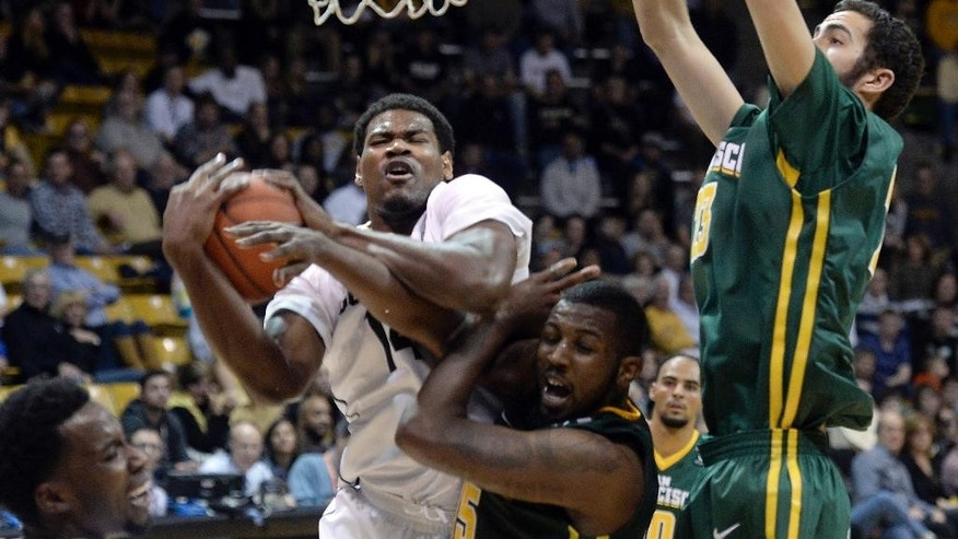 Colorado's Tory Miller snags a rebound over Kruize Pinkins in the second half of an NCAA basketball game against San Francisco on Wednesday, Dec. 3, 2014, at the Coors Event Center in Boulder, Colo. (AP Photo/The Daily Camera, Jeremy Papasso)