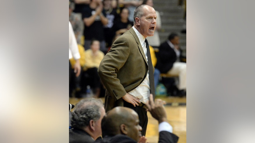 University of Colorado head coach Tad Boyle yells to his team during an NCAA basketball game against San Francisco on Wednesday, Dec. 3, 2014, at the Coors Event Center in Boulder, Colo. (AP Photo/The Daily Camera, Jeremy Papasso)