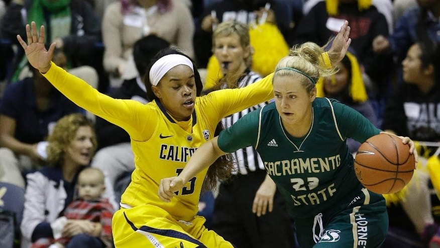 Sacramento State forward Hallie Gennett (23) drives against California guard Brittany Boyd (15) during the first half an NCAA college basketball game in Berkeley , Calif., Wednesday, Dec. 3, 2014. (AP Photo/Jeff Chiu)