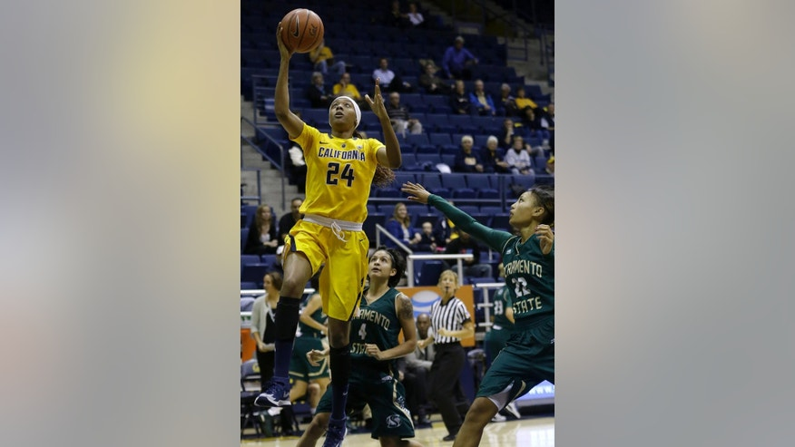 California forward Courtney Range (24) shoots against Sacramento State guard Ericka Magana (4) and guard Maranne Johnson (22) during the first half an NCAA college basketball game in Berkeley , Calif., Wednesday, Dec. 3, 2014. (AP Photo/Jeff Chiu)