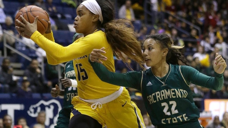 California guard Brittany Boyd (15) drives past Sacramento State guard Maranne Johnson (22) during the first half an NCAA college basketball game in Berkeley , Calif., Wednesday, Dec. 3, 2014. (AP Photo/Jeff Chiu)
