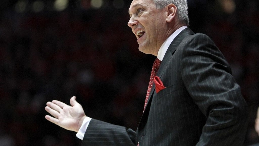 New Mexico head coach Craig Neal reacts during an NCAA college basketball game against New Mexico State, Wednesday, Dec. 3, 2014, in Albuquerque, N.M. (AP Photo/Mark Holm)