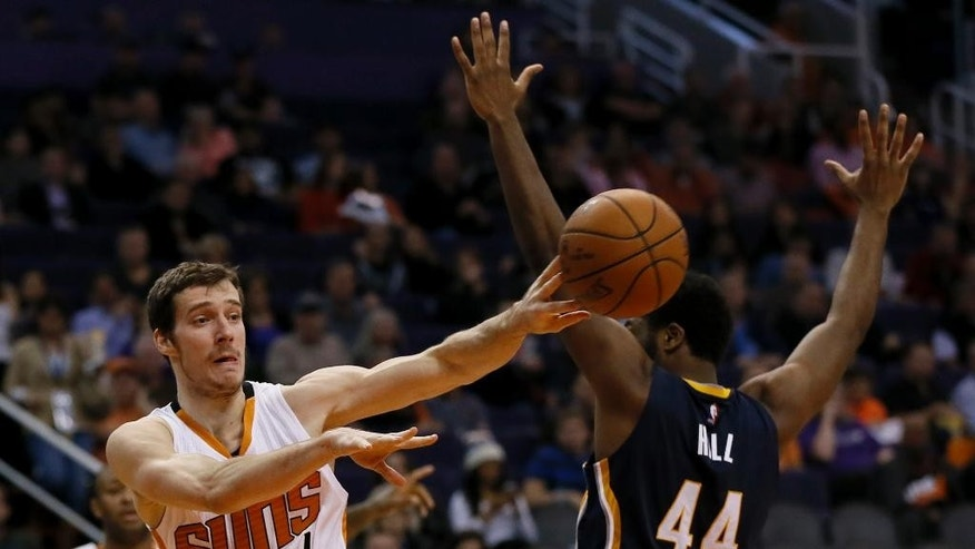 Phoenix Suns guard Goran Dragic, of Slovenia, (1), dishes around Indiana Pacers forward Solomon Hill (44) during the second half of an NBA basketball game, Tuesday, Dec. 2, 2014, in Phoenix. The Suns won 116-99. (AP Photo/Matt York)