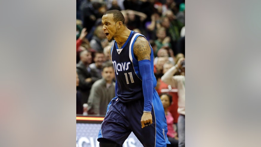 Dallas Mavericks' Monta Ellis reacts after making the game-winning basket in the final seconds of the second half of an NBA basketball game against the Milwaukee Bucks Wednesday, Dec. 3, 2014, in Milwaukee. The Mavericks won 107-105. (AP Photo/Morry Gash)