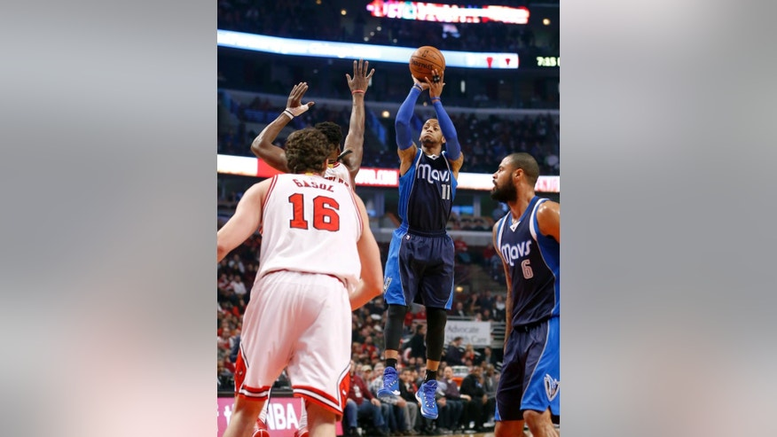 Dallas Mavericks guard Monta Ellis (11) shoots over Chicago Bulls guard Jimmy Butler and Pau Gasol (16), during the first half of an NBA basketball game Tuesday, Dec. 2, 2014, in Chicago. (AP Photo/Charles Rex Arbogast)
