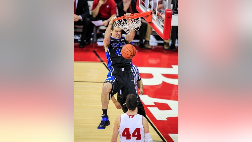 Duke's Marshall Plumlee dunks over Wisconsin's Frank Kaminsky on a steal during the first half of an NCAA college basketball game Wednesday, Dec. 3, 2014, in Madison, Wis. (AP Photo/Andy Manis)