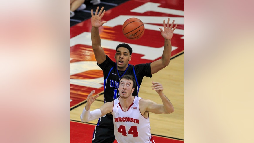 Wisconsin's Frank Kaminsky (44) and Duke's Jahlil Okafor eye a loose ball during the first half of an NCAA college basketball game Wednesday, Dec. 3, 2014, in Madison, Wis. (AP Photo/Andy Manis)