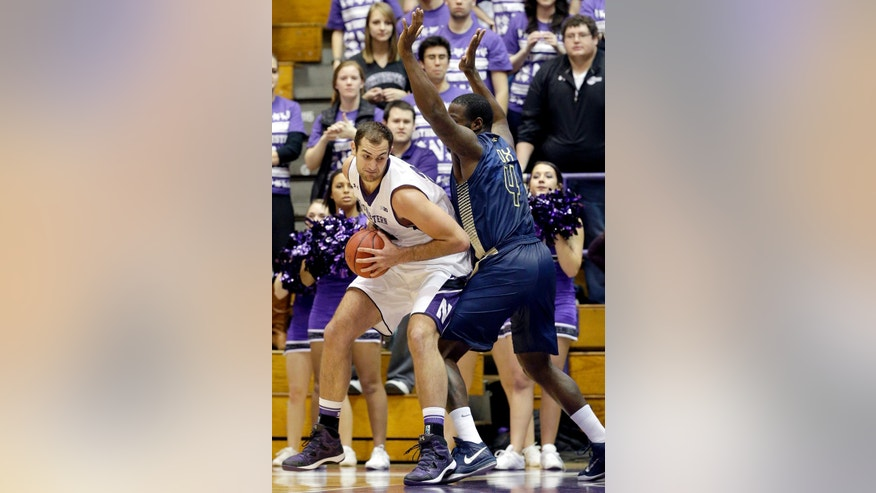 Northwestern center Alex Olah, left, drives against Georgia Tech center Demarco Cox (4) during the first half of an NCAA college basketball game in Evanston, Ill., on Wednesday, Dec. 3, 2014. (AP Photo/Nam Y. Huh)