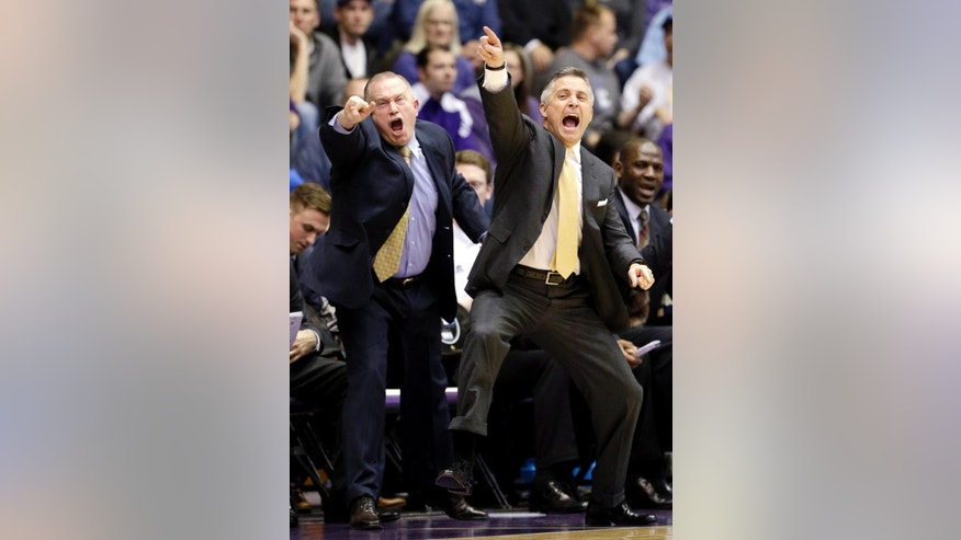 Georgia Tech head coach Brian Gregory, right, and assistant coach Tom Herrion yell to their team during the first half of an NCAA college basketball game against Northwestern in Evanston, Ill., on Wednesday, Dec. 3, 2014. (AP Photo/Nam Y. Huh)