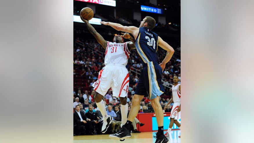 Houston Rockets guard Jason Terry, left, shoots as Memphis Grizzlies forward Jon Leuer defends in the second half of an NBA basketball game, Wednesday, Dec. 3, 2014, in Houston. (AP Photo/Eric Christian Smith)