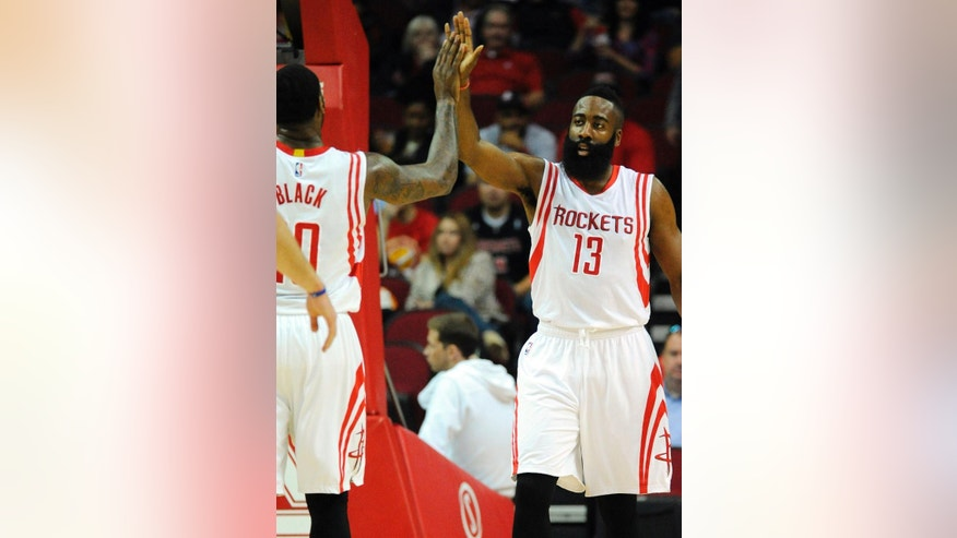 Houston Rockets guard James Harden, right, celebrates a basket with center Tarik Black in the first half of an NBA basketball game against the Memphis Grizzlies, Wednesday, Dec. 3, 2014, in Houston. (AP Photo/Eric Christian Smith)