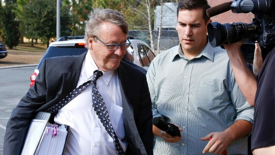 Baine Kerr, left, the attorney for the alleged victim of Florida State quarterback Jameis Winston, arrives at Florida State's Materials Research building for his student Conduct code hearing, Tuesday, Dec. 2, 2014, in Tallahassee, Fla. (AP Photo/Don Juan Moore)