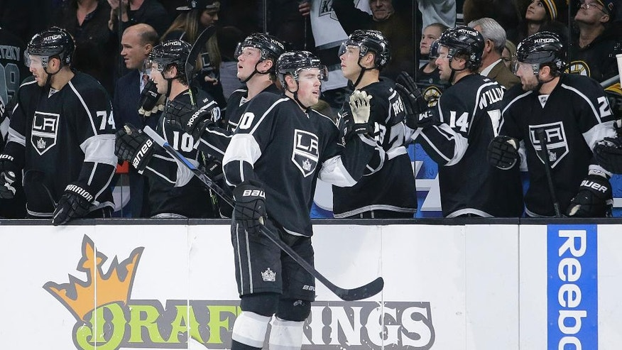 Los Angeles Kings' Tanner Pearson, center, celebrates his goal with teammates during the first period of an NHL hockey game against the Boston Bruins, Tuesday, Dec. 2, 2014, in Los Angeles. (AP Photo/Jae C. Hong)