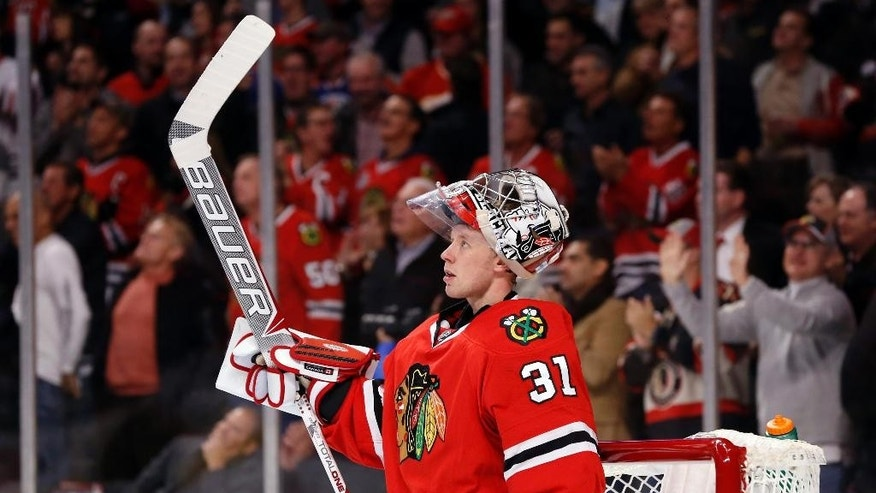Chicago Blackhawks goalie Antti Raanta looks up at the scoreboard during a break in the first period of an NHL hockey game against the St. Louis Blues, Wednesday, Dec. 3, 2014, in Chicago. (AP Photo/Charles Rex Arbogast)