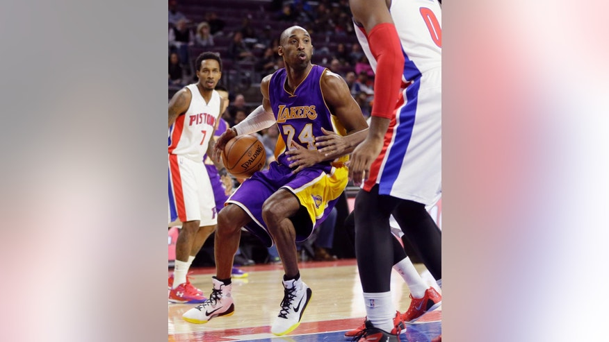 Los Angeles Lakers guard Kobe Bryant (24) looks to pass during the first half of an NBA basketball game against the Detroit Pistons in Auburn Hills, Mich., Tuesday, Dec. 2, 2014. (AP Photo/Carlos Osorio)