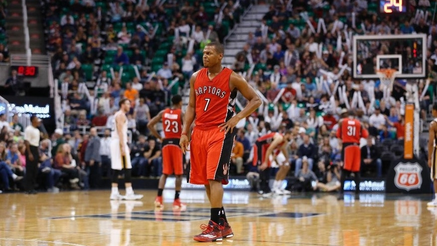 Toronto Raptors guard Kyle Lowry (7) after a play during the second half of an NBA basketball game against the Utah Jazz, Wednesday, Dec. 3, 2014 in Salt Lake City. The Toronto Raptors won 123-104. (AP Photo/Jim Urquhart)