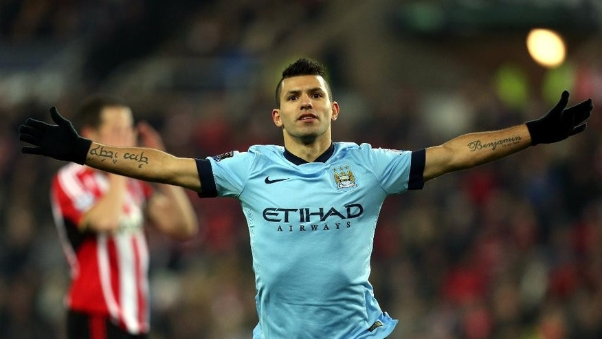 Manchester City's Sergio Aguero celebrates his goal during their English Premier League soccer match against Sunderland at the Stadium of Light, Sunderland, England, Wednesday, Dec. 3, 2014. (AP Photo/Scott Heppell)