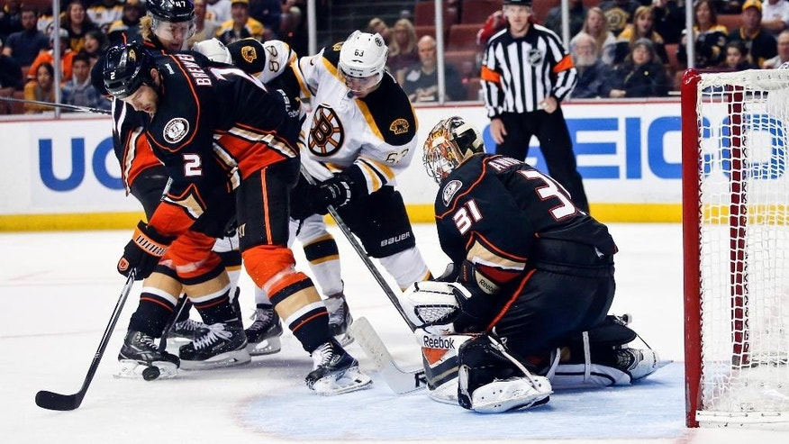 Anaheim Ducks defenseman Eric Brewer, left, grabs the rebound after a stop by Ducks' goalie Frederik Andersen during the third period of an NHL hockey game Monday, Dec. 1, 2014, in Anaheim, Calif. (AP Photo/Lenny Ignelzi)