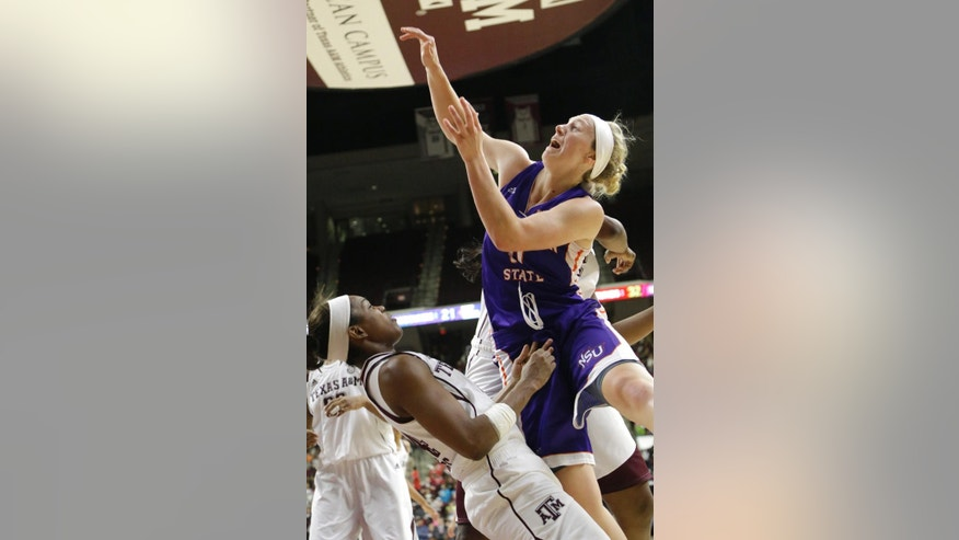 Northwestern State's Meghan Cross, right, earns a fouls as she knocks over Texas A&M's Jordan Jones during the second half of an NCAA college basketball game Wednesday, Dec. 3, 2014, in College Station, Texas. Texas A&M won 75-42. (AP Photo/Pat Sullivan)