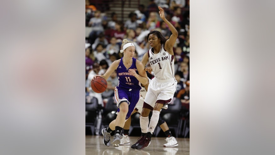 Northwestern State's Meghan Cross (11) drives the ball past Texas A&M's Courtney Williams (1) during the first half of an NCAA college basketball game Wednesday, Dec. 3, 2014, in College Station, Texas. (AP Photo/Pat Sullivan)