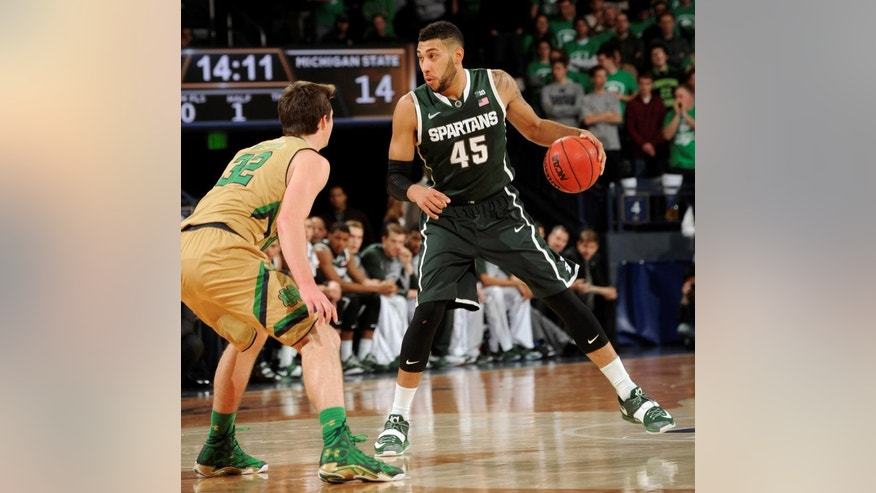Michigan State guard Denzel Vaentine, right, heads up court as Notre Dame guard Steve Vasturia defends during the first half of an NCAA college basketball game Wednesday Dec. 3, 2014, in South Bend, Ind.  (AP Photo/Joe Raymond)